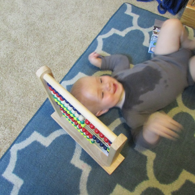 baby plays abacus